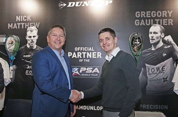 Tommy Berden, right, chief commercial officer for the Professional Squash Association, shakes hands with Dunlop's UK general manager Steve Heatley to mark their new three-year extended deal ©PSA