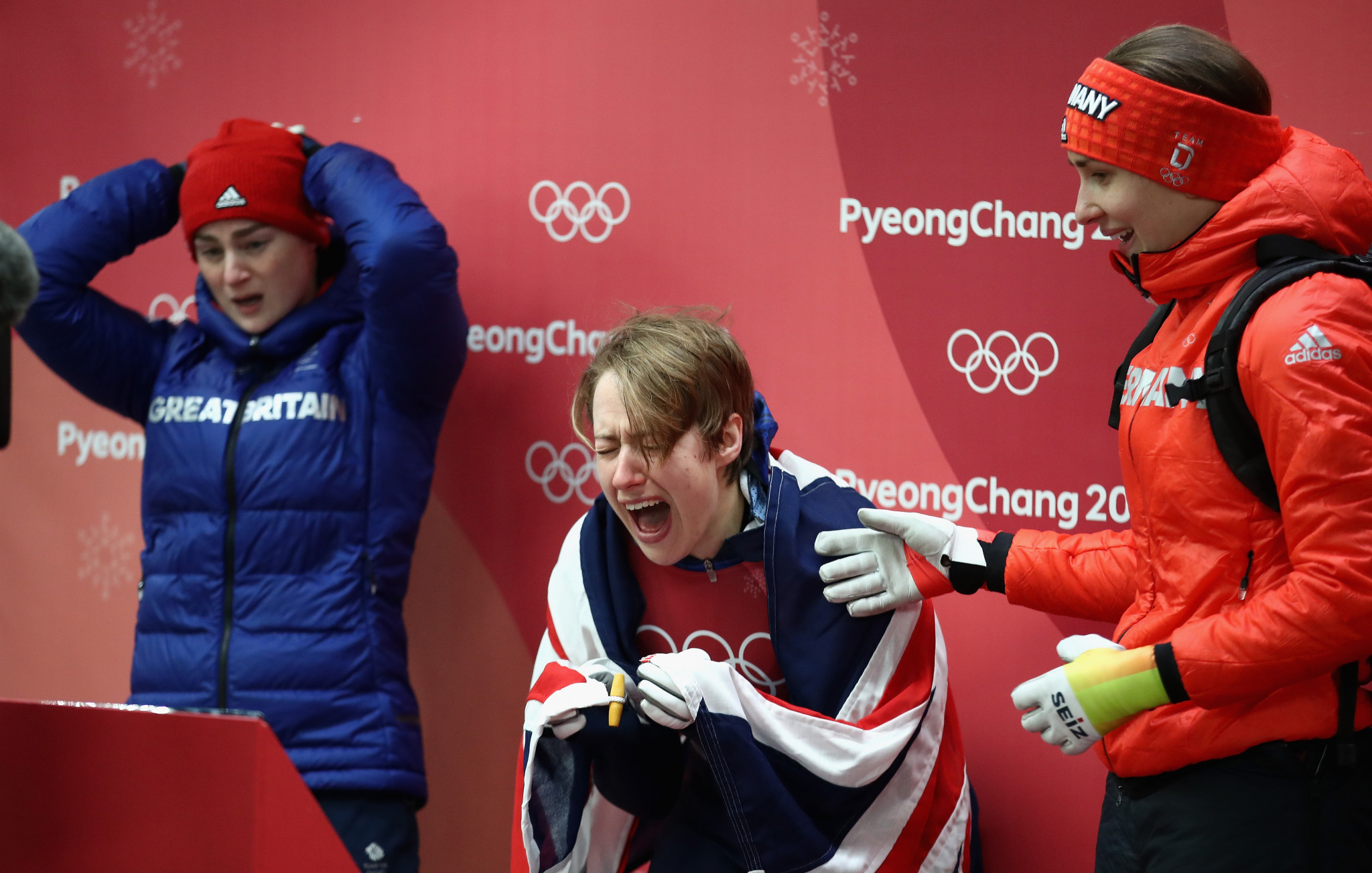 Britain's Lizzy Yarnold celebrates after realising she has become a double Olympic champion ©Getty Images