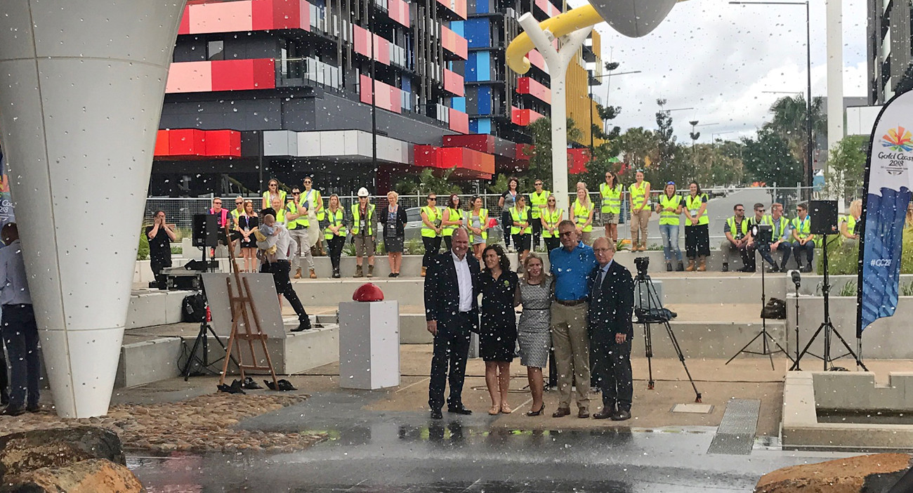 Co-Mayors Mark Stockwell, second right, and Sara Carrigan, second left, helped turn on a fountain located in the middle of the Athletes Village following the announcement of their appointments ©Gold Coast 2018