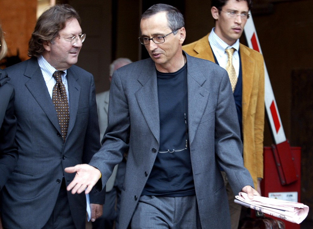 Michele Ferrari (centre) is set to provide evidence to the Italian National Olympic Committee prosecutor this week ©CONI
