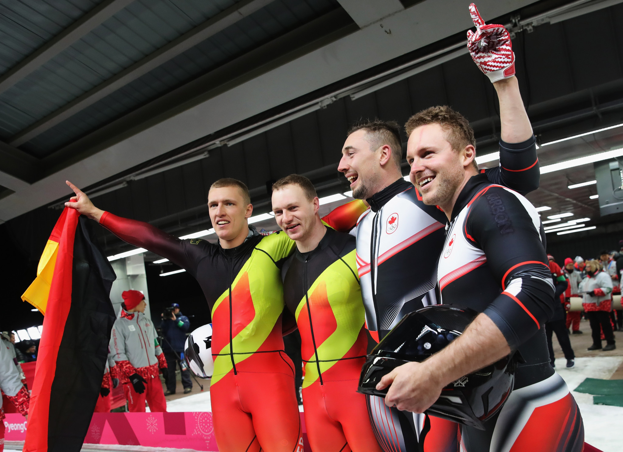 Germany and Canada celebrate joint gold in bobsleigh ©Getty Images