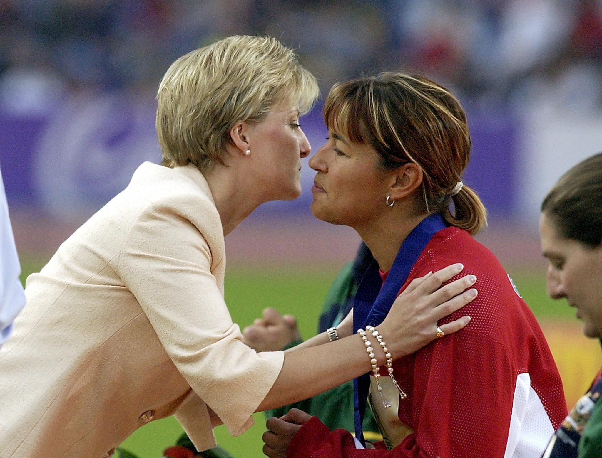 Chantal Petitclerc receives her 2002 Commonwealth Games gold medal from the  Countess of Wessex after winning the 800m - the first time an event for an athlete with a disability had been part of the officiall programme ©Getty Images