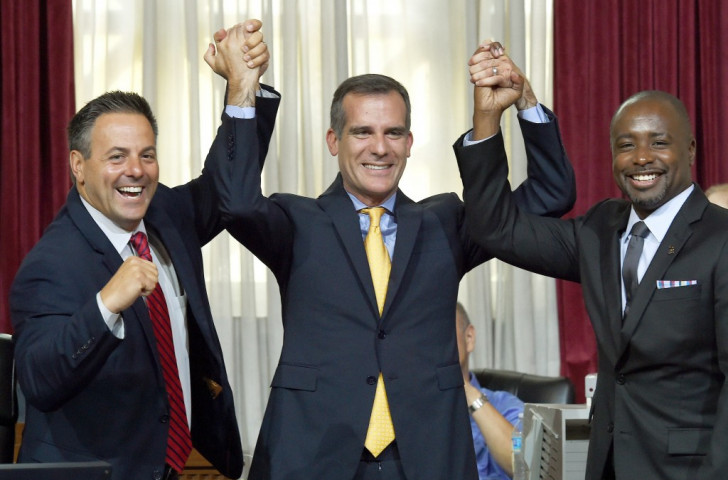 Los Angeles Mayor Eric Garcetti (centre) celebrates with Los Angeles City Councilmen Joe Buscaino (left) and Marqueece Harris-Dawson (right) after the Council voted to bid for the 2024 Olympic and Paralympic Games
