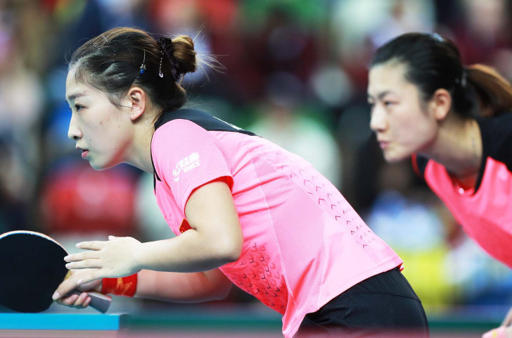 Liu Shiwen, left, and Olympic and world champion Ding Ning en route to victory in the opening doubles against Japan as China earned a tenth ITTF Team World Cup title at London's Copper Box Arena ©Getty Images