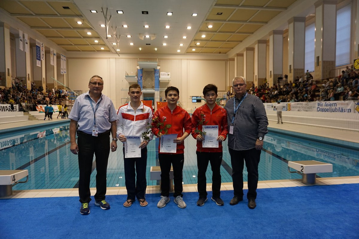 Bo Qiu, centre, touched perfection as China dominated the FiNA Diving Grand Prix in Rostock  ©Twitter