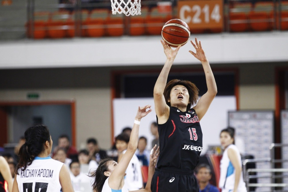 Japan beat hosts China in dramatic circumstances at the Asia Women's Championship in Wuhan