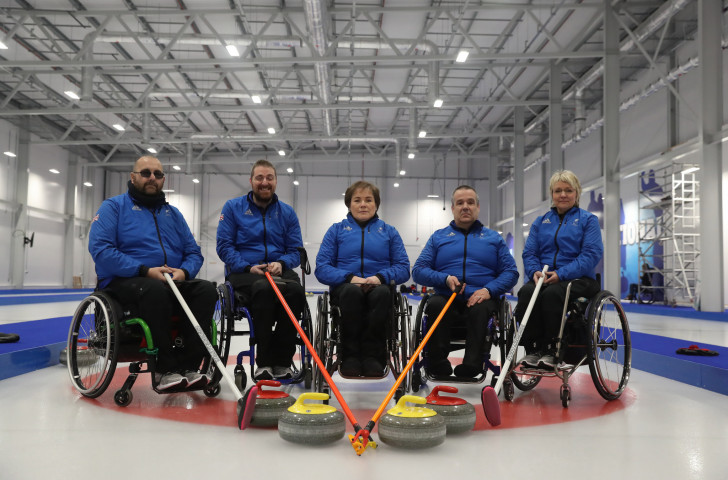 The ParalympicsGB wheelchair curling team for next month's Pyeongchang Games line up at the National Curling Centre - they and all other Para-athletes under the UK banner have a new code of classification ©Getty Images