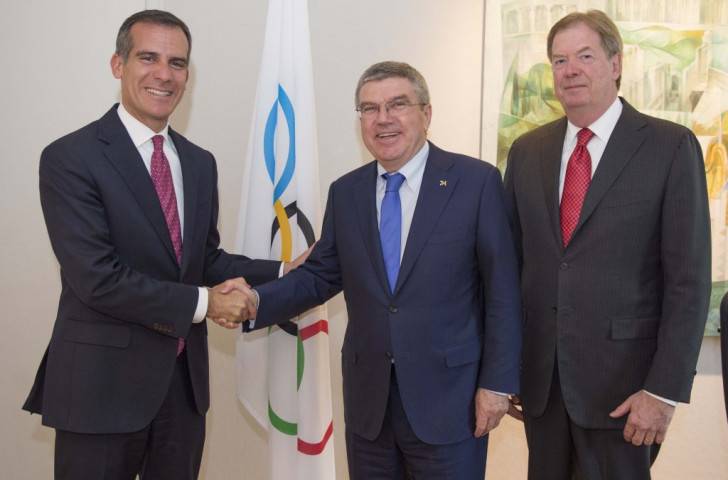 Los Angeles Mayor Eric Garcetti (left) with IOC President Thomas Bach (centre) and USOC chairman Larry Probst (right) in Lausanne