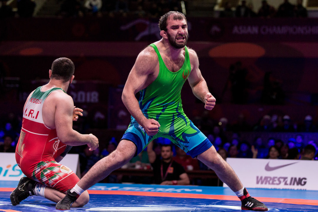 An exhausted Magomed Ibragimov of Uzbekistan acclaims victory at the Asian Wrestling Championships ©UWW